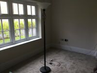 Black metal floor standing lamp with twist design and glass lamp shade