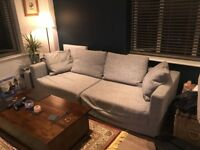 Comfortable and stylish grey three seater sofa for FREE