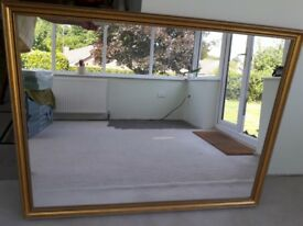 Large gold framed mirror in good condition