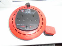 JOJO 12m, 2 SOCKET, EXTENSION LEAD in PULL OUT RETRACTABLE ROUND PLASTIC HOLDER