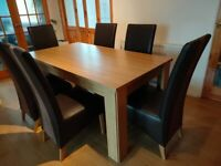 SOLID OAK DINING TABLE AND 6 LEATHER LOOK CHAIRS