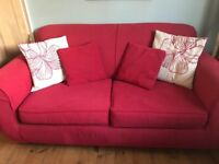 Dark pink sofa bed with 4 cushions