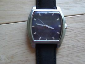 ben sherman square blue face and new black strap in great condition no scratches or marks,