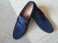 A Pair of Men's Blue Suede Loafers