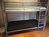 Ikea Blue metal framed bunk bed.
