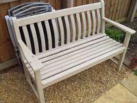 Cream wooden garden bench seat.