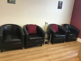 Immaculate Black leather look tub chairs. No marks or tears.