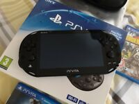 PlayStation Vita Slim. Console and one game only.