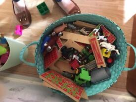 Wooden toy farm with 8 tractors and lots of animals