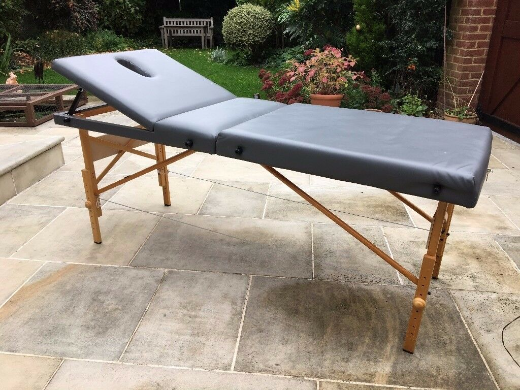 Portable massage bench with carrier bag