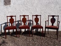 Four G-plan solid wood dinning chairs, One Carver and three standard seats