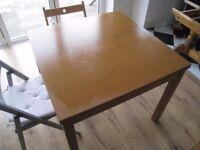 Ikea Bjusta extending dining table