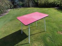 1950's RED FORMICA TOPPED TABLE WITH WHITE STEEL LEGS.... VERY KITCH AND RETRO.