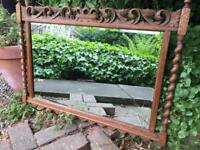 Vintage oak mirror with patina marks under the pain