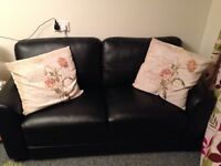 Perfect small black faux leather 2 seater sofa