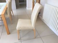 Extending dining room table and 6 leather-look chairs
