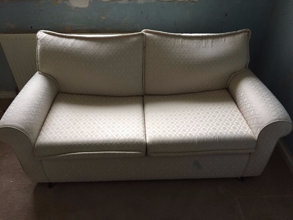 "Sofa Bed in Ivoryin Droylsden, ManchesterGumtree - Sofa Bed in Ivory A good quality sofa bed finished in ivory. Seen very little use and features two seats and a quality folding mechanism. Mark to the bottom front (see image). Measures approx H 29"" x W 64"" x D 32"". Bed when opened has a length of..."