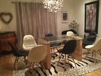 Very large dining table with 4 black & 4 cream eames style chairs. Very usual and contemporary