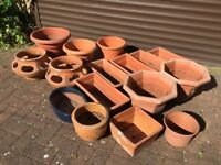 Lots of garden plant pots plastic and ceramic pots