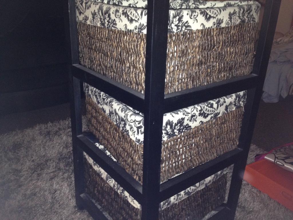 Corner brown wooden/woven lined basket storage