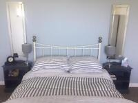 White metal double bed frame.