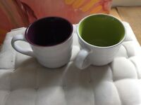 8 large mugs. White with coloured interiors