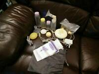 Medela Swing Breast Pump with extras