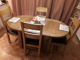 Solid rustic oak extending oval dining table and 4 chairs