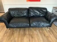 Black leather suite 3 and 2 seater.