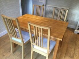 Solid Oakwood IKEA dining table and 4 chairs - first to see will buy!