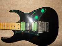 Ibanez RG series Guitar. Black with green fittings.