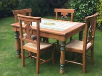 Mexican Pine table and 4 matching chairs. Table has tiles with lemons on.