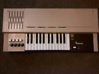 Vintage brown Bontempi electric organ.
