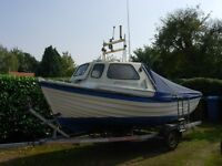 Sea Nymph 17/Orkney shape cuddy fishing boat on roller trailer with new fitted cover