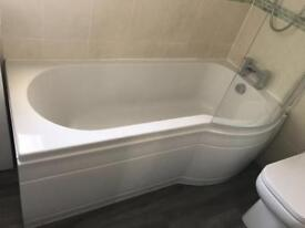 White bath including waterfall tap