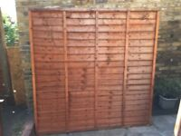 Champion Timber Overlap Fence Panels One Year Old. Four 6x6ft (1830x1830) and one 6x5ft (1830x1525)
