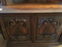 Coffee table / Storage cabinet , with carved doors and original handles . Must be seen .