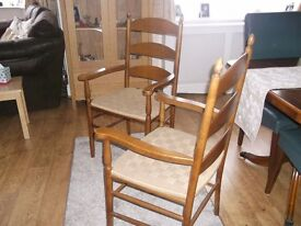 A PAIR OF HIGH BACK CARVER CHAIRS