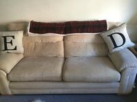 Two Beige sofas settee large and Pouffe footstool