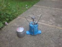 Camping gas compact stove with spare unused gas cylinder
