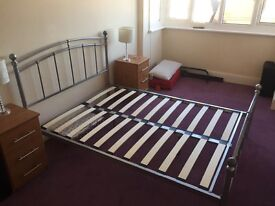 Double metal bed frame for sale - good condition.