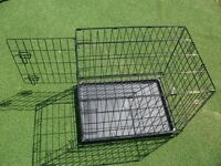 Dog crate for a small to medium pet...folds flat, as new. In Ruskington