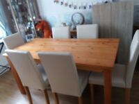 lovely table and 6 chairs very small mark on table but hardly visible only 12 months old