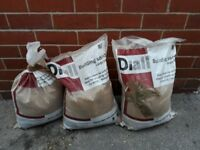 Three small bags of building sand