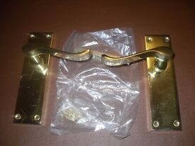 long back scroll latch brass effect door handles.