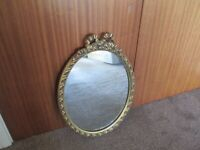 vintage bow topped oval mirror