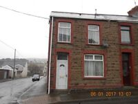 A three bedroom end of terrace property situated in Caerau