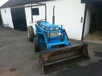Ford 1520 tractor with front loader and cultivator