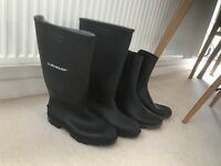 Two pairs of black gumboots (size 8 UK and size 9 UK)