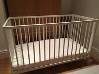 White Ikea cot with mattress (converts to bed)